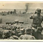 unsere_waffen_ss_post_card_in_battle_around_a_soviet_village.jpg