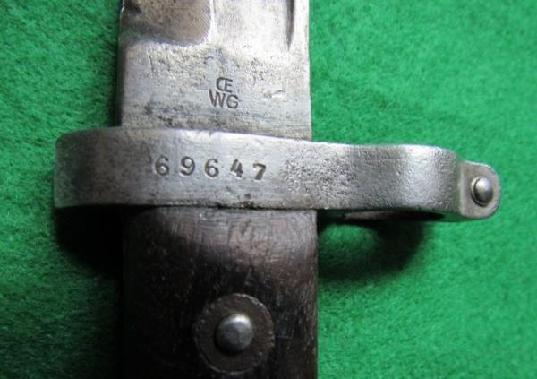 приемна маркировка – контурен лъв, върху кръстачката на щик, произведен от Щаер