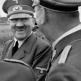 Смеющийся Гитлер и его окружение во время прогулки во Франции